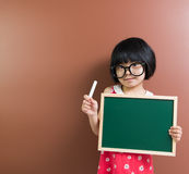 Asian school kid with chalk and chalkboard Royalty Free Stock Photography