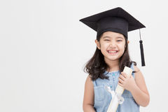 Asian school kid graduate in graduation cap. Happy Asian school kid graduate in graduation cap royalty free stock images