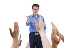 Asian school teacher. Male asian school teacher, isolated on white Royalty Free Stock Photo