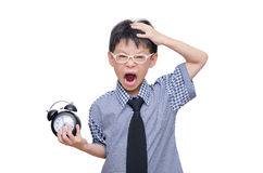Asian schoolboy holding clock and screaming Stock Photo