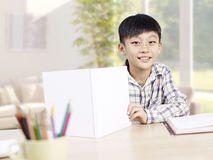 Asian schoolboy studying at home Stock Photography