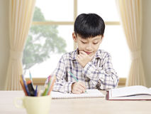 Asian schoolboy studying at home Royalty Free Stock Images