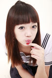 Asian schoolgirl. Cute Asian schoolgirl in uniform on white Stock Image