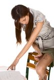 Asian schoolgirl cheating during math test Royalty Free Stock Image