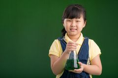 Asian schoolgirl with a flask Stock Images