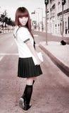 Asian schoolgirl outdoors. Stock Photography