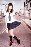 Asian schoolgirl outdoors. Stock Photo