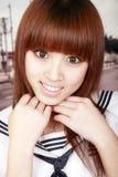 Asian schoolgirl portrait. Cute Asian schoolgirl in uniform outdoor portrait Royalty Free Stock Photo