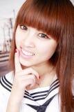 Asian schoolgirl portrait. Cute Asian schoolgirl in uniform outdoor portrait Royalty Free Stock Image