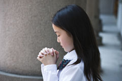 Asian schoolgirl praying Stock Photo