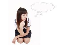 Asian schoolgirl thinking. Asian schoolgirl in uniform thinking on white Stock Image