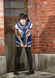 Asian schoolgirl in uniform outside school Royalty Free Stock Photography