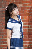 Asian schoolgirl in uniform outside school Stock Image