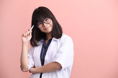 Asian scientist holding pen thinking Stock Photos