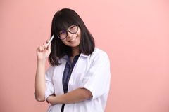 Asian scientist holding pen thinking Royalty Free Stock Photo