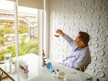 Asian scientist Look at the Beaker royalty free stock photos