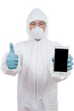 Asian scientist in protective wear holding smartphone with thumb Royalty Free Stock Images