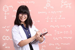 Asian scientist taking note on tablet Royalty Free Stock Images