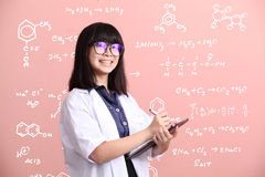 Asian scientist taking note on tablet Royalty Free Stock Image
