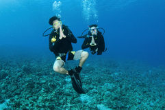 Asian Scuba divers. Make Thai wai sign Stock Photos