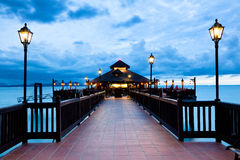 Asian sea shore restaurant. Authentic asian seas shore restaurant in luxury resort at dusk stock photos