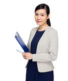 Asian secretary with file pad Royalty Free Stock Photo
