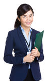 Asian secretary holding folder Royalty Free Stock Image