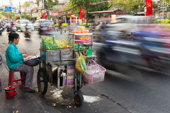 Asian seller long exposure on traffic road Stock Photo
