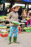 Asian selling fresh fish in street fruit and vegetable market Royalty Free Stock Photos