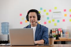 Free Asian Senior Business Man Wearing Earphone Meeting With Business Team Via Video Conference Call At Home Royalty Free Stock Photography - 195540717