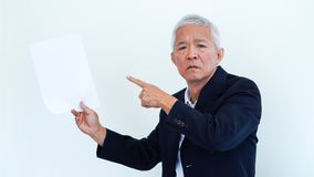 Asian senior businessman unhappy angry expression for report res. Asian senior businessman unhappy angry expression for result copy space Stock Images