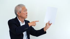 Asian senior businessman unhappy angry expression for report res. Asian senior businessman unhappy angry expression for result copy space Royalty Free Stock Images