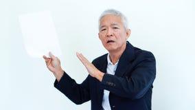 Asian senior businessman unhappy angry expression for report res. Asian senior businessman unhappy angry expression for result copy space Royalty Free Stock Photo