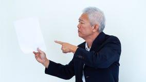 Asian senior businessman unhappy angry expression for report res. Asian senior businessman unhappy angry expression for result copy space Stock Photo