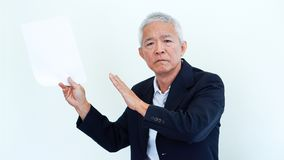 Asian senior businessman unhappy angry expression for report res. Asian senior businessman unhappy angry expression for result copy space Stock Photos