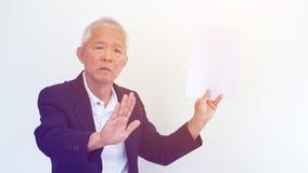 Asian senior businessman unhappy angry expression for report res. Asian senior businessman unhappy angry expression for result copy space Royalty Free Stock Image