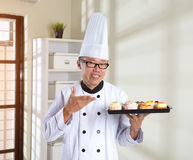Asian senior chef Stock Photos