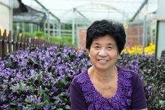 Asian senior citizen. Portrait of Asian senior citizen smiling at lavender garden royalty free stock photo