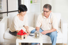 Asian senior couple calculating Stock Images