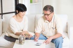 Asian senior couple calculating Stock Photography