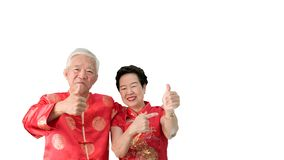 Asian senior couple celebrate Chinese new year in red traditional costume stock image