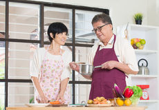 Asian senior couple cooking Royalty Free Stock Photo