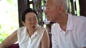 Asian senior couple discuss family problems seriously. 4k stock video footage