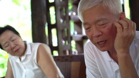 Asian senior couple discuss family problems together. 4k stock video footage