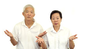 Asian senior couple do not like a deal. Upset and do not satisfy Royalty Free Stock Photography