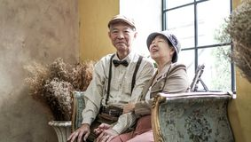 Asian senior couple smiling dress vintage retro style in luxury Royalty Free Stock Images