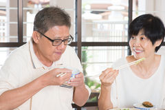 Asian Senior Couple Eating Royalty Free Stock Photos