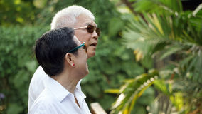 Asian senior couple with green tropical nature background Stock Image
