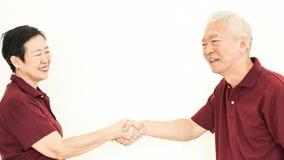 Asian senior couple happy together expression white background stock photo
