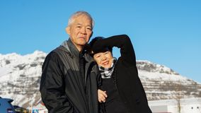 Asian senior couple have fun in Europe portrait with snow mountain background. Asian senior couple have fun in Europe portrait with snow mountain royalty free stock photo